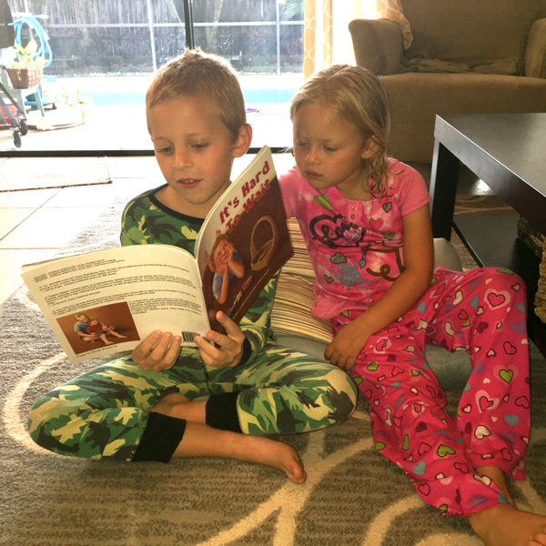 Grandson with his new book and sister.