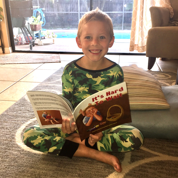 Grandson with his new book.